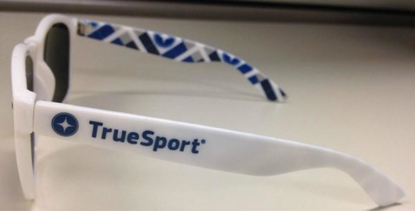 TrueSport branded white sunglasses with blue lenses.